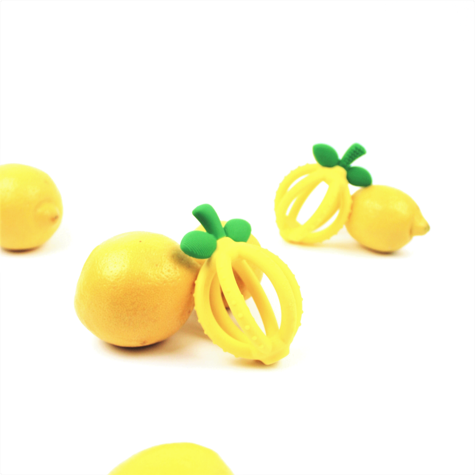 itzy-ritzy-teether-ball-lemon-group